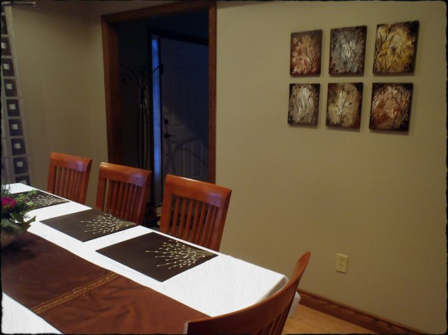 The paintings hung in the dining room. They kind of match the place mats.